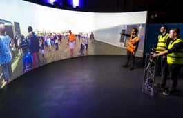 Students using the interactive screen in the simulation centre