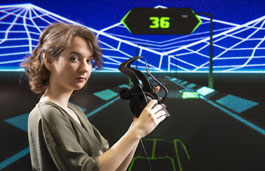 Female student with virtual reality headset against a virtual digital screen