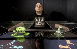 Student stood behind a 3D digital animation