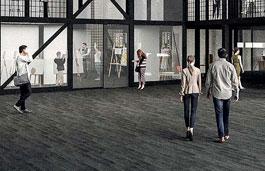 People walking across the floor of a large open plan building