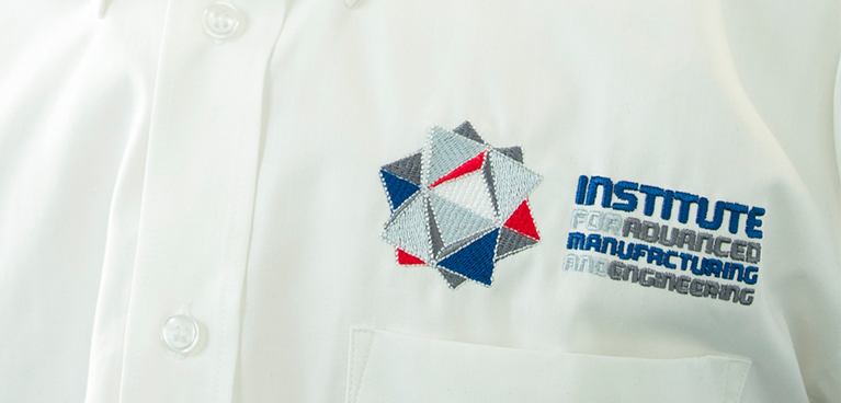 AME logo on a white shirt