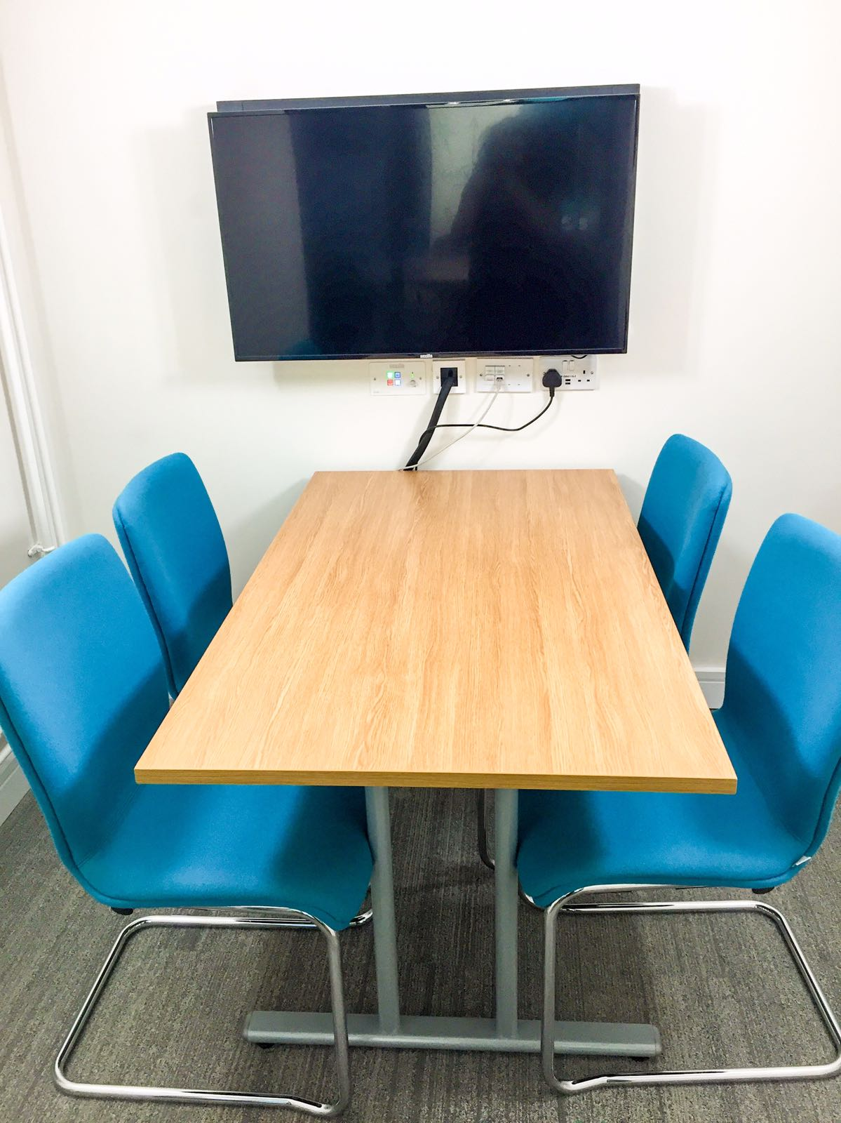 one table and four chairs in the Enterprise Hub meeting room