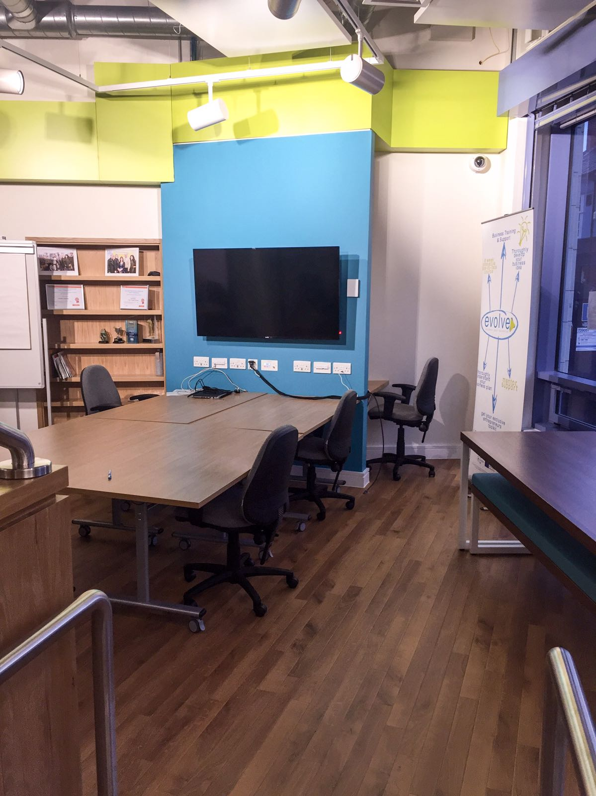 enterprise hub meeting room with table and chairs