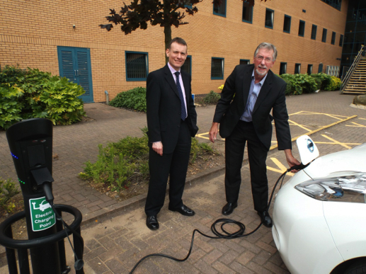 Day 2, (l-r): Dr David Jarvis (SURGE, Coventry University) and Mike Woollacott (Greenwatt) charging a Nissan Leaf outside the Technocentre, Coventry University.