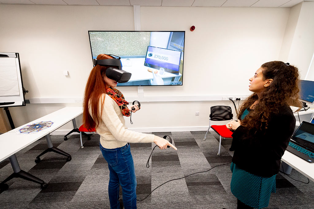 1 female demonstrating virtual reality headset