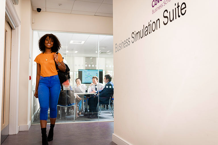 Student outside business simulation suite
