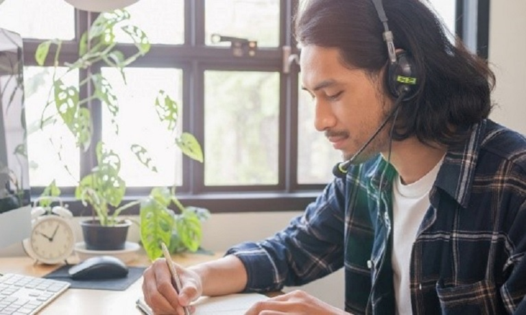 Student writing on a virtual call