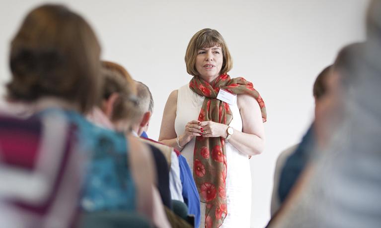 Megan Crawford presenting a seminar to a group of students