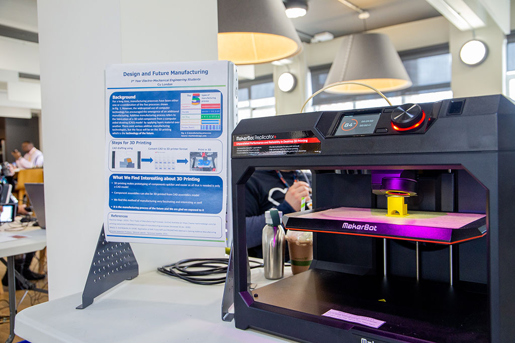 Engineering student pop-up stand featuring a 3D printer